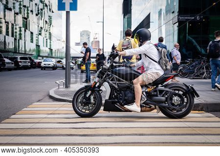 Russia Moscow 2019-06-17 Man Casual Clothes Style On Black Motorcycle Cruiser Ducati Diavel I