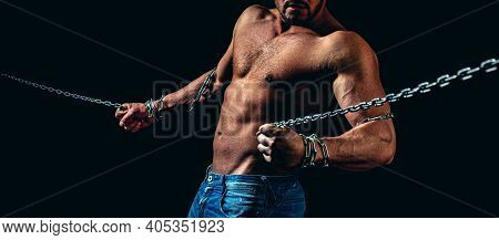 Fetter. Concept Of Salvation. Muscular Man Posing With Metal Chain. Perfect Body