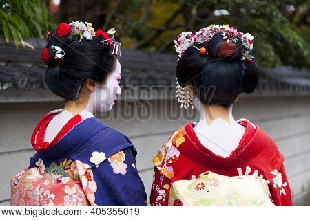 Kyoto, Japan - Dec 6 : Apprentice Geisha,maiko With Umbrella In Kyoto, Japan On December 6,2015. App