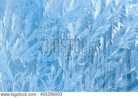 Frosty Patterns On The Window At Dawn. Frosty Window Texture. Abstract Background.
