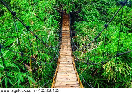 Traditional Construction Suspension Pedestrian Bridge Made From Natural Bamboo. Cable Bridge Crossin