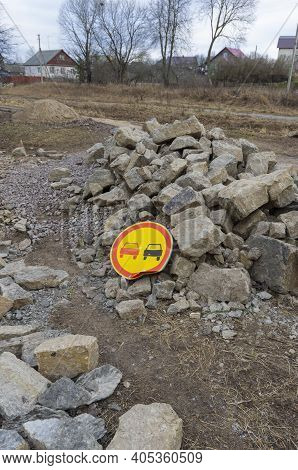Widespread Road Sign 'no Overtaking' Fallen On Large Pile Of Stones Vertical Orientation
