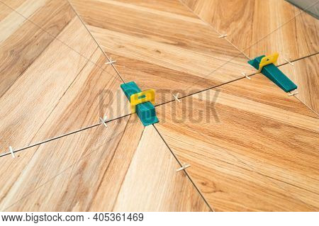 Tiling Work. Layed Tiles With Crosses For Tiles And 3d Crosses. Wood-effect Floor Tiles. Herringbone