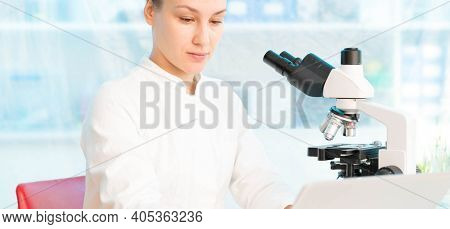 Food test in laboratory, Researcher with GMO plants. transgenic plant is an plant whose genetic material has been altered using genetic engineering techniques.
