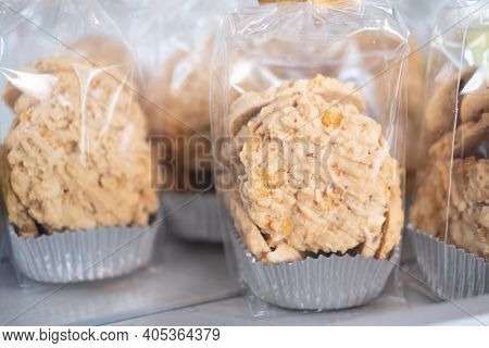 Cookies In Plastic Bags On Shelf For Sell In The Coffee Shop.