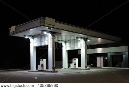 Modern Gas Station With Convenience Store Beside The Road At Night