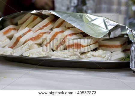Photo of delicious Sandwiches with salmon on tray poster