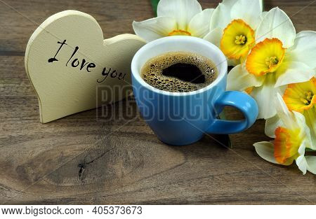 I Love You. Valentine's Day Card. Cup Of Coffee And Spring Flowers On Wooden Table. Daffodils And A