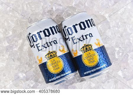 IRVINE, CALIFORNIA - MARCH 21, 2018: two 12 ounce cans of Corona Extra Cerveza on ice. Corona Extra is a pale lager produced by Cerveceria Modelo in Mexico for domestic distribution and export.