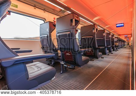 Interior Of A Train Compartment Of The German Railway During The Journey. Empty Seats In First Class