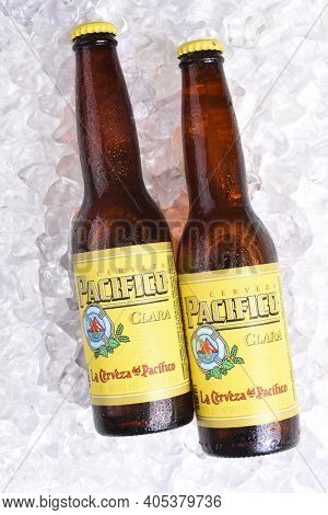 IRVINE, CALIFORNIA - JANUARY 22, 2017: 2 Bottles of Cerveza Pacifico Clara on Ice, better known as Pacifico, is a Mexican pilsner-style beer, brewed in in the Pacific Ocean port city of Mazatlan.