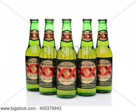IRVINE, CA - MAY 27, 2014: Five Bottles of Dos Equis Lager Especial on white with reflection.