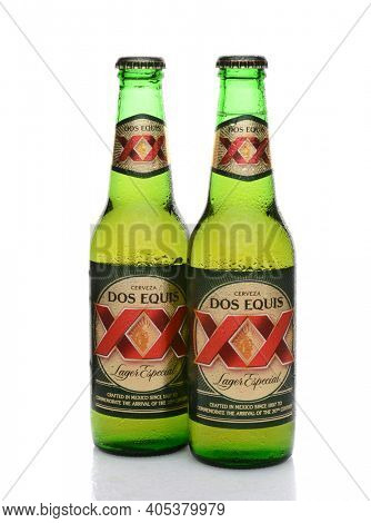 IRVINE, CA - MAY 25, 2014: Two Bottles of Dos Equis Lager Especial with condensation. Founded in 1890 from the Cuauhtemoc-Moctezuma Brewery in Monterrey, Mexico a subsidary of Heineken International.