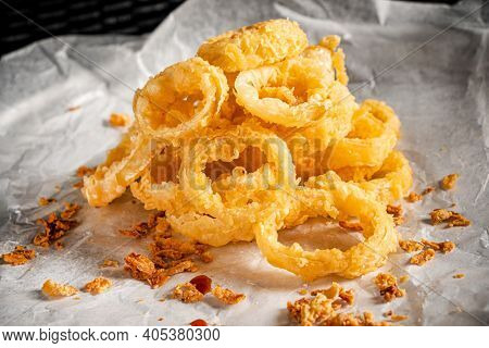 Delicious golden battered, breaded and deep fried crispy onion rings