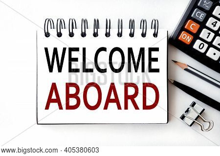 Welcome Aboard, Text On White Paper, On Notepad Paper, On A Light Background, Near The Calculator