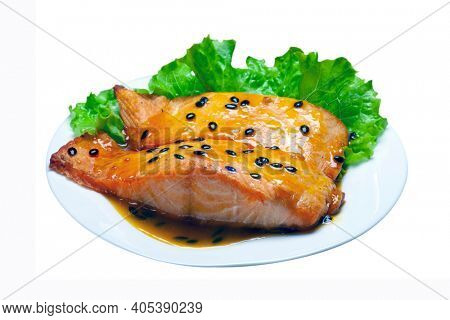 grilled salmon with salad and passion fruit sauce, isolated on white background