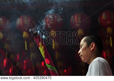 Jakarta, Indonesia - January 29, 2017: Chinese People With Big Incense Pray To The Gods In Chinese L