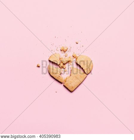 Broken Heart Cookies On Pink Background. Unrequited Love And Cracked Relationship Concept