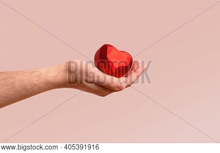 Man Hand Holding Red Ring Box On Pastel Trendy Color. Romantic Poster For Propose Greeting Card. Val