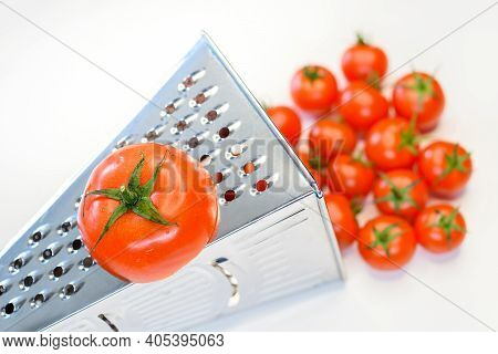 The Grated Tomato Turns Into Cherry Tomatoes. Weird Culinary Concept Photo