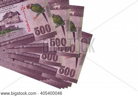 500 Sri Lankan Rupees Bills Lies In Small Bunch Or Pack Isolated On White. Mockup With Copy Space. B