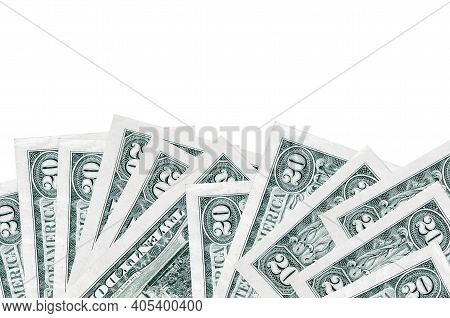 20 Us Dollars Bills Lies On Bottom Side Of Screen Isolated On White Background With Copy Space. Back
