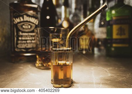 Poland, Warsaw - April 24, 2020: Bong With Cognac And Whiskey On A Background Of Alcohol. Glass With