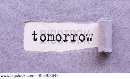 The Text Tomorrow Appears On Torn Lilac Paper Against A White Background.