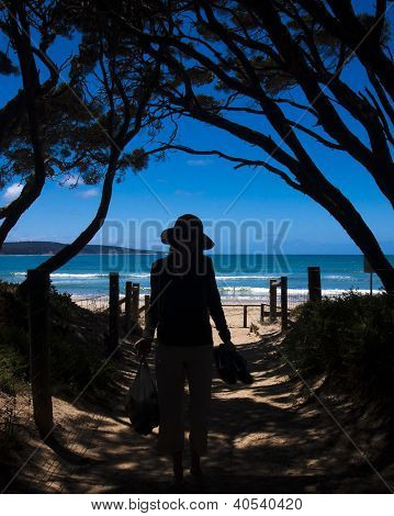 Woman walking to beach