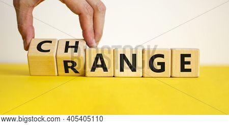 Change Range Symbol. Businessman Turns Cubes And Changes The Word 'change' To 'range'. Beautiful Yel