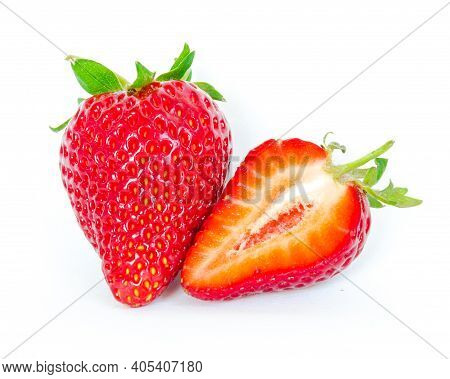 One Strawberry Fruit And A Half Cut Isolated On White Background With Copy Space