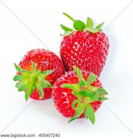 Three Strawberry Fruits Isolated On White Background With Copy Space