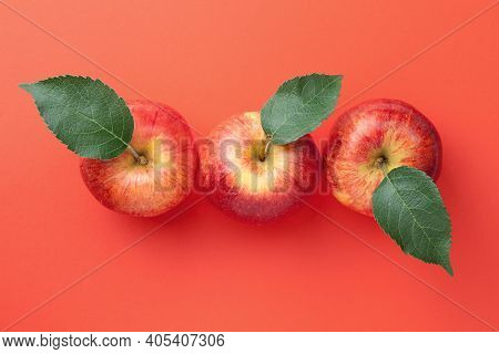 Red Apples With Leaves Over Paper Background. Gala Apple Composition. View From Above
