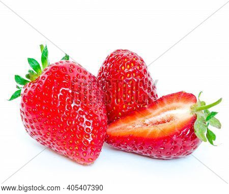 Two Strawberry Fruits And A Half Cut Isolated On White Background With Copy Space