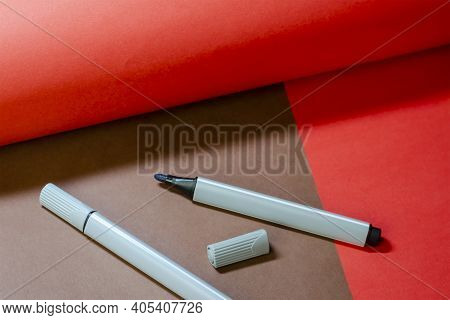 Creative Minimalist Two-color Composition With Two Felt-tip Pens. Gray Felt-tip Pens On A Brown And