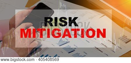 A Man Searches For Information On The Internet About Investments With Risk Mitigation