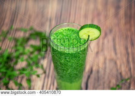 Healthy Food And Vegan Diet Concept - Glass Of Fresh Green Juice Or Smoothie With Kiwi, Spinach, Ban