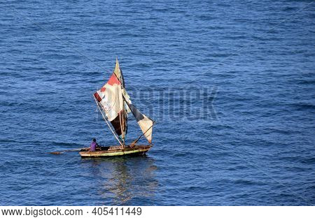 Old Wooden Boat From Leftover Materials Sailing The Open Sea