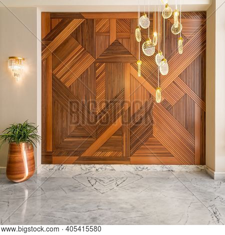 Hall With Wood Cladding Wall Decorated With Geometrical Patterns, Tall Rounded Wooden Planter With G