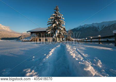 Wildermieming, Tirol, Austria - 16 January 2021 - Deep Snow Trail Path To Former Film Location Of Th