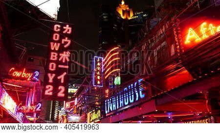 Bangkok, Thailand, 13 July 2019: Vivid Neon Signs Glowing On Soi Cowboy Street. Nightlife In Erotic