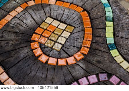 Mosaic Tiles On Round Cut Down Tree With Cracks Stump Outside. Diy Garden Furniture, Decorated By Ha