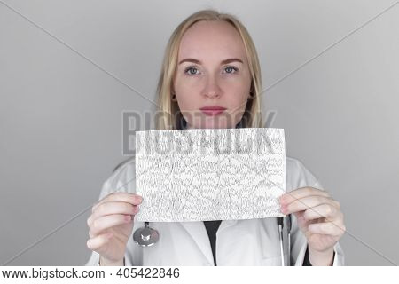 A Neurologist Examines An Encephalogram Of A Patient\'s Brain. Schedule Of Electroencephalograms Stu