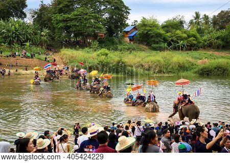 Sukhothai, Thailand - April 7, 2018 : Elephants And Ordained Man To Travel Across The River In Annua