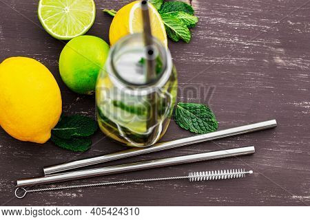 Cold Drink In Mason Jar With Metal Straws On Wooden Table. Lemonade Or Detox Water With Lime And Thy