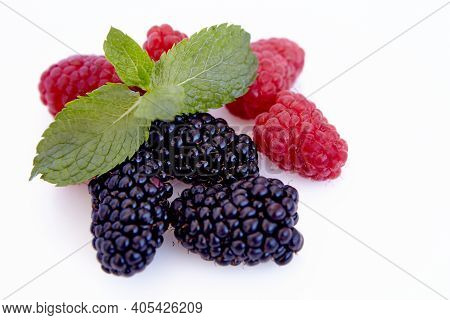 Raspberry And Blackberry And Mint Isolated On White Background. Vegan Food, Detox Concept