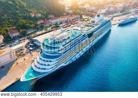 Aerial View Of Cruise Ship At Harbor At Sunset. Beautiful Large Ships And Boats. Landscape With Boat