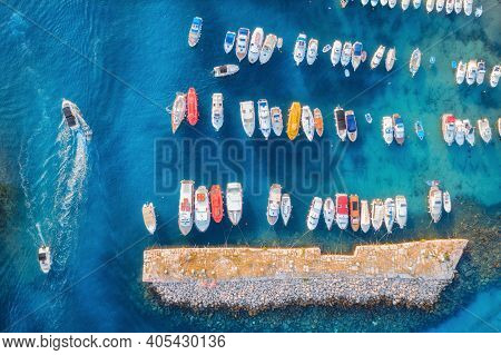 Aerial View Of Colorful Boats And Yachts In Port In Blue Sea At Sunset. Summer Landscape With Beauti