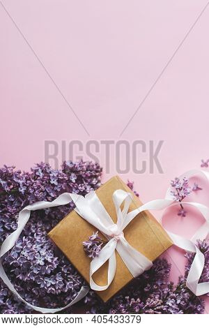 Lilac Flowers And Gift Box On Pink Paper, Stylish Flat Lay With Copy Space. Happy Mothers Day