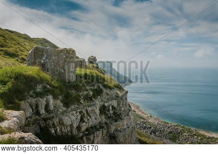 The Cliffs Of The Jurassic Coast, Isle Of Portland, Portland, Dorset, Uk On A Hazy And Sunny Summer
